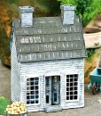 Miniature fairy garden Early American house