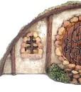 Miniature hillside Hobbit house