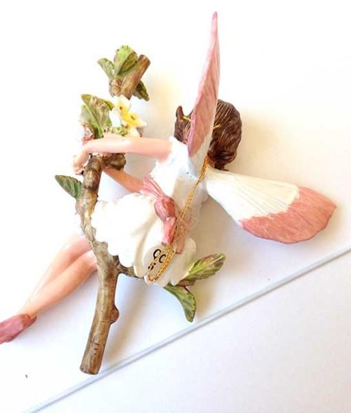 White fairy blossom fairy figurine